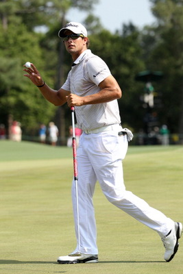 AUGUSTA, GA - APRIL 10:  Adam Scott of Australia waves to the gallery on the eighth green during the final round of the 2011 Masters Tournament at Augusta National Golf Club on April 10, 2011 in Augusta, Georgia.  (Photo by Andrew Redington/Getty Images)