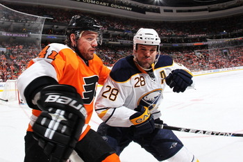 PHILADELPHIA - MARCH 05:  Paul Gaustad #28 of the Buffalo Sabres checks Andrej Meszaros #41 of The Philadelphia Flyers during their game on March 5, 2011 at The Wells Fargo Center in Philadelphia, Pennsylvania.  (Photo by Al Bello/Getty Images)