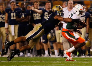 PITTSBURGH - SEPTEMBER 23:  Jacory Harris #12 of the Miami Hurricanes is tackled by Jabaal Sheard #97 of the Pittsburgh Panthers on September 23, 2010 at Heinz Field in Pittsburgh, Pennsylvania.  (Photo by Jared Wickerham/Getty Images)
