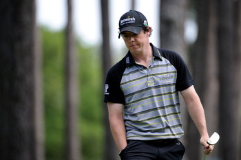 AUGUSTA, GA - APRIL 10:  Rory McIlroy of Northern Ireland walks across the sixth green during the final round of the 2011 Masters Tournament on April 10, 2011 in Augusta, Georgia.  (Photo by Harry How/Getty Images)