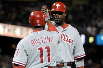 SAN FRANCISCO - OCTOBER 20:  Ryan Howard #6 of the Philadelphia Phillies celebrates with Jimmy Rollins #11 after scoring in the eighth inning against the San Francisco Giants in Game Four of the NLCS during the 2010 MLB Playoffs at AT&T Park on October 20
