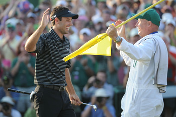 AUGUSTA, GA - APRIL 10:  Charl Schwartzel of South Africa celebrates his two-stroke victory with his caddie Greg Hearmon on the 18th green during the final round of the 2011 Masters Tournament at Augusta National Golf Club on April 10, 2011 in Augusta, Ge