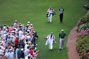 AUGUSTA, GA - APRIL 10:  Rory McIlroy of Northern Ireland and Angel Cabrera of Argentina walk with their caddies on the sixth hole during the final round of the 2011 Masters Tournament at Augusta National Golf Club on April 10, 2011 in Augusta, Georgia.