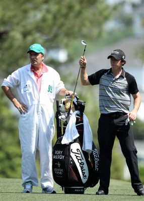 AUGUSTA, GA - APRIL 10:  Rory McIlroy of Northern Ireland (R) pulls a club from his bag alongside caddie J.P. Fitzgerald during the final round of the 2011 Masters Tournament at Augusta National Golf Club on April 10, 2011 in Augusta, Georgia.  (Photo by
