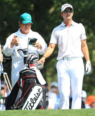 AUGUSTA, GA - APRIL 10:  Adam Scott of Australia chats with his caddie Tony Navarro on the fourth hole during the final round of the 2011 Masters Tournament on April 10, 2011 in Augusta, Georgia.  (Photo by David Cannon/Getty Images)