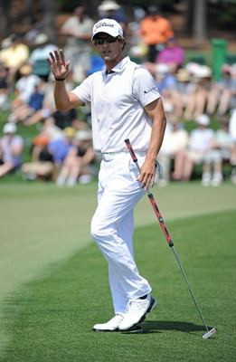 AUGUSTA, GA - APRIL 10:  Adam Scott of Australia waves to the gallery on the second hole during the final round of the 2011 Masters Tournament on April 10, 2011 in Augusta, Georgia.  (Photo by Harry How/Getty Images)