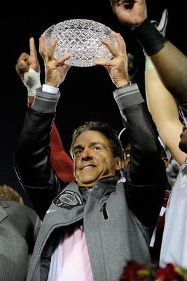 PASADENA, CA - JANUARY 07:  Head coach Nick Saban and the Alabama Crimson Tide celebrate with the BCS Championship trophy after winning the Citi BCS National Championship game over the Texas Longhorns at the Rose Bowl on January 7, 2010 in Pasadena, Calif