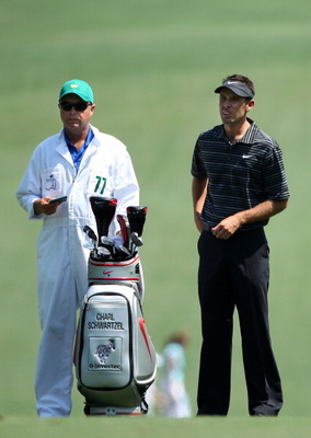 AUGUSTA, GA - APRIL 10:  Charl Schwartzel of South Africa and caddie Greg Hearmon look on from the first hole fairway during the final round of the 2011 Masters Tournament at Augusta National Golf Club on April 10, 2011 in Augusta, Georgia.  (Photo by And