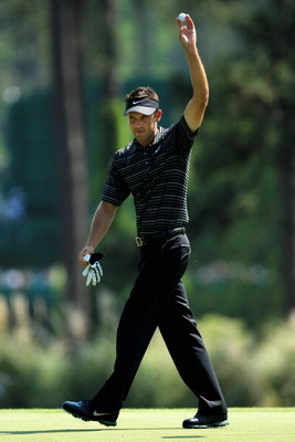 AUGUSTA, GA - APRIL 10:  Charl Schwartzel of South Africa celebrates after holing a shot for eagle on the third green during the final round of the 2011 Masters Tournament on April 10, 2011 in Augusta, Georgia.  (Photo by David Cannon/Getty Images)