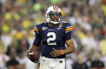 GLENDALE, AZ - JANUARY 10:  Cameron Newton #2 of the Auburn Tigers scrambles against the Oregon Ducks during the Tostitos BCS National Championship Game at University of Phoenix Stadium on January 10, 2011 in Glendale, Arizona.  (Photo by Christian Peters