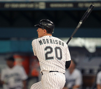 MIAMI GARDENS, FL - APRIL 01: Logan Morrison #20 of the Florida Marlins hits a solo home run during opening day against the New York Mets at Sun Life Stadium on April 1, 2011 in Miami Gardens, Florida.  (Photo by Mike Ehrmann/Getty Images)