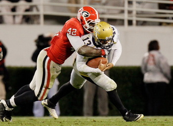 ATHENS, GA - NOVEMBER 27:  Justin Houston #42 of the Georgia Bulldogs sacks quarterback Tevin Washington #13 of the Georgia Tech Yellow Jackets at Sanford Stadium on November 27, 2010 in Athens, Georgia.  (Photo by Kevin C. Cox/Getty Images)