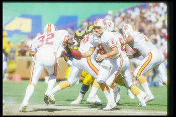 5 Oct 1986:  Quarterback Steve Young of the Tampa Bay Buccaneers looks to hand off the ball during a game against the Los Angeles Rams at Anaheim Stadium in Anaheim, California.  The Rams won the game in overtime, 26-20. Mandatory Credit: Rick Stewart  /A
