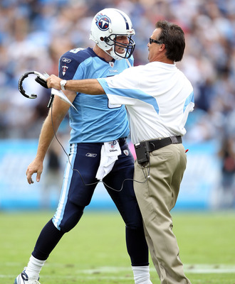 NASHVILLE, TN - OCTOBER 24:  Kerry Collins #5 of the Tennessee Titans celebrates with Titans Head Coach Jeff Fisher after Collins threw a touchdown pass in the fourth quarter during the NFL game against the Philadelphia Eagles at LP Field on October 24, 2