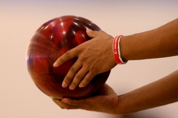 GUANGZHOU, CHINA - NOVEMBER 17: Kien Ling liew of Malaysia competes in his  Bowling match against Men's doubles during day five of the 16th Asian Games Guangzhou 2010 at Tianhe Bowling Hall on November 17, 2010 in Guangzhou, China.  (Photo by Lintao Zhang