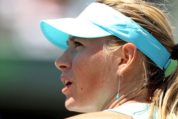 KEY BISCAYNE, FL - APRIL 02:  Maria Sharapova of Russia looks on against Victoria Azarenka of Belarus during the women's singles championship at the Sony Ericsson Open at Crandon Park Tennis Center on April 2, 2011 in Key Biscayne, Florida.  (Photo by Al