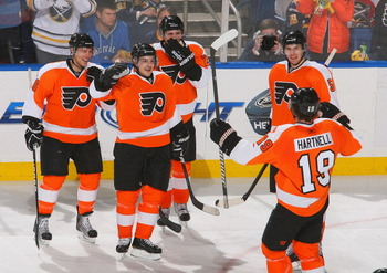 BUFFALO, NY - APRIL 08: Daniel Briere #48 (2nd from left) of the Philadelphia Flyers celebrates scoring Philadelphia's third goal against the Buffalo Sabres  at HSBC Arena on April 8, 2011 in Buffalo, New York.  (Photo by Rick Stewart/Getty Images)