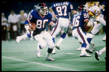 28 Oct 1984: Wide receiver Phil McConkey of the New York Giants runs with the ball during a game against the Washington Redskins in Giants Stadium at the Meadowlands in East Rutherford, New Jersey. The Giants won the game 37-13.