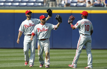 ATLANTA, GA - APRIL 9: Shane Victorino #8, Raul Ibanez #29 and Ben Francisco #10 of the Philadelphia Phillies celebrate after the game against the Atlanta Braves at Turner Field on April 9, 2011 in Atlanta, Georgia. The Phillies won 10-2. (Photo by Joe Ro