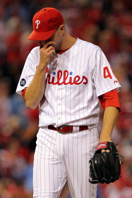 PHILADELPHIA - OCTOBER 23:   Ryan Madson #46 of the Philadelphia Phillies reacts after giving up a solo homerun to Juan Uribe #5 of the San Francisco Giants in the eigth inning against the Philadelphia Phillies in Game Six of the NLCS during the 2010 MLB