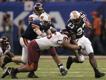 NEW ORLEANS - JANUARY 03:  Running back Ronnie Brown #23 of the Auburn Tigers avoids the tackle of Jim Davis #95 of the Virginia Tech Hokies during the Nokia Sugar Bowl on January 3, 2005 at the Superdome in New Orleans, Louisiana.  (Photo by Chris Grayth