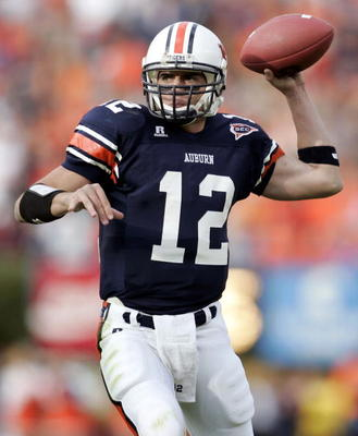 AUBURN, AL - NOVEMBER 19:  Quarterback Brandon Cox #12 of Auburn University throws a pass against the University of Alabama  on November 19, 2005 at Jordan-Hare Stadium in Auburn, Alabama.   (Photo by Chris Graythen/Getty Images)