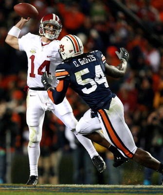 AUBURN, AL - NOVEMBER 24:  Quarterback John Parker Wilson #14 of the Alabama Crimson Tide is forced to get rid of the ball early by linebacker Quentin Groves #54 of the Auburn Tigers at Jordan-Hare Stadium on November 24, 2007 in Auburn, Alabama.  Auburn