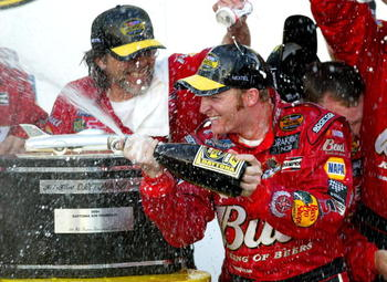 DAYTONA BEACH, FL - FEBRUARY 15:  Dale Earnhardt Jr. driver of the #8 DEI Budweiser Chevrolet celebrates by spraying champagne in victory circle after winning the the NASCAR Nextel Cup Daytona 500 on February 15, 2004 at the Daytona International Speedway