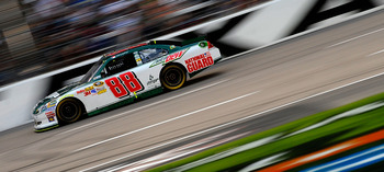 FORT WORTH, TX - APRIL 09:  Dale Earnhardt Jr., driver of the #88 Amp Energy/National Guard Chevrolet, races during the NASCAR Sprint Cup Series Samsung Mobile 500 at Texas Motor Speedway on April 9, 2011 in Fort Worth, Texas.  (Photo by Jared C. Tilton/G