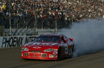 PHOENIX, AZ- NOVEMBER 2:  Dale Earnhardt Jr. celebrates his victory in his #8 Budweiser Chevrloet during the NASCAR Winston Cup Checker Auto Parts 500 on November 2, 2003 at Phoenix International Raceway in Phoenix, Arizona. (Photo by Jon Ferrey/Getty Ima