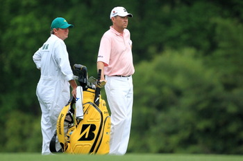 AUGUSTA, GA - APRIL 08:  Davis Love III waits with his caddie Jef Weber during the second round of the 2011 Masters Tournament at Augusta National Golf Club on April 8, 2011 in Augusta, Georgia.  (Photo by David Cannon/Getty Images)