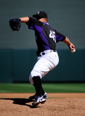 SCOTTSDALE, AZ - MARCH 14:  Pitcher Jhoulys Chacin #45 of the Colorodo Rockies throws against the Cincinnati Reds  during the spring training baseball game at Salt River Fields at Talking Stick on March 14, 2011 in Scottsdale, Arizona.  (Photo by Kevork D