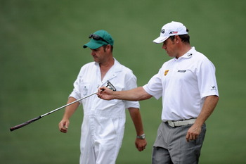 AUGUSTA, GA - APRIL 09:  Lee Westwood of England waits with his caddie Billy Foster on the second hole during the third round of the 2011 Masters Tournament at Augusta National Golf Club on April 9, 2011 in Augusta, Georgia.  (Photo by Harry How/Getty Ima