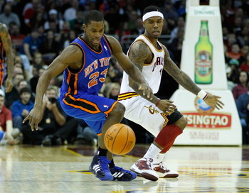 CLEVELAND - FEBRUARY 25:  Toney Douglas #23 of the New York Knicks and Daniel Gibson #1 of the Cleveland Cavaliers fight for a loose ball during the game on February 25, 2011 at Quicken Loans Arena in Cleveland, Ohio. NOTE TO USER: User expressly acknowle