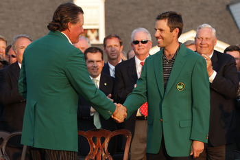 AUGUSTA, GA - APRIL 10:  Phil Mickelson (L) shakes hands with Charl Schwartzel of South Africa at the green jacket presentation after Schwartzel's two-stroke victory at the 2011 Masters Tournament at Augusta National Golf Club on April 10, 2011 in Augusta