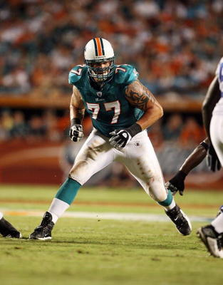 MIAMI - SEPTEMBER 21:  Offensive tackle Jake Long #77 of the Miami Dolphins drops back into pass blocking against the Indianapolis Colts at Land Shark Stadium on September 21, 2009 in Miami, Florida. The Colts defeated the Dolphins 27-23.  (Photo by Doug