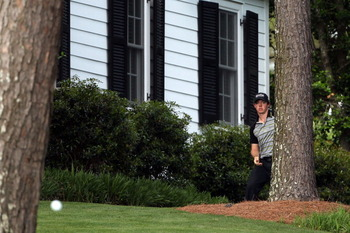 AUGUSTA, GA - APRIL 10:  Rory McIlroy of Northern Ireland plays a shot back to the fairway on the tenth hole after an errant tee shot during the final round of the 2011 Masters Tournament at Augusta National Golf Club on April 10, 2011 in Augusta, Georgia
