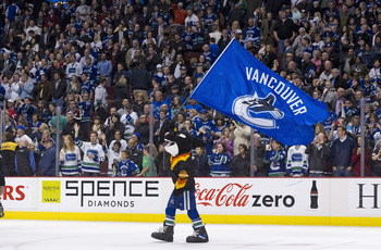 VANCOUVER, CANADA - APRIL 7: Fin, mascot of the Vancouver Canucks waves a team flag on the ice after the Vancouver Canucks defeated the Minnesota Wild in NHL action on April 07, 2011 at Rogers Arena in Vancouver, BC, Canada.  (Photo by Rich Lam/Getty Imag