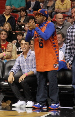 MIAMI, FL - FEBRUARY 27: Director Spike Lee watches a game between the Miami Heat and the New York Knicks at American Airlines Arena on February 27, 2011 in Miami, Florida. NOTE TO USER: User expressly acknowledges and agrees that, by downloading and/or u