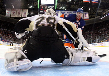 UNIONDALE, NY - APRIL 08:  Marc-Andre Fleury #29 of the Pittsburgh Penguins stops John Tavares #91 of the New York Islanders during the shootout at the Nassau Coliseum on April 8, 2011 in Uniondale, New York. The Penguins defeated the Islanders 4-3 in the