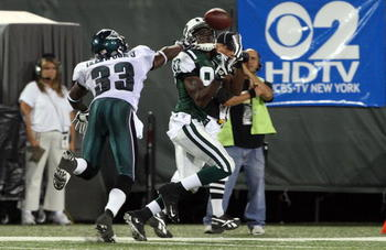 EAST RUTHERFORD, NJ - SEPTEMBER 03:  David Clowney #87 of the New York Jets makes a catch for a touchdown against Jack Ikegwuonu #33 of the Philadelphia Eagles on September 3, 2009 at Giants Stadium in East Rutherford, New Jersey. The Jets defeated the Ea