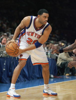 NEW YORK - DECEMBER 21:  Allan Houston #20 of the New York Knicks holds the ball against the Dallas Mavericks on December 21, 2004 at Madison Square Garden in New York City.  The Mavs won 123-94. NOTE TO USER: User expressly acknowledges and agrees that,
