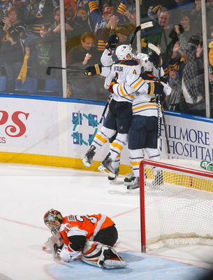 BUFFALO, NY - APRIL 08: Players from the Buffalo Sabres skate to Thomas Vanek #26  after Vanek scored the game winning goal in overtime against Sergei Bobrovsky #35 of the Philadelphia Flyers at HSBC Arena on April 8, 2011 in Buffalo, New York. Buffalo wo