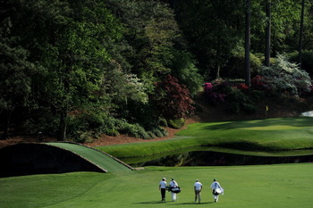 AUGUSTA, GA - APRIL 09:  (L-R) Rory McIlroy of Northern Ireland, caddie J.P. Fitzgerald, Jason Day of Australia and caddie Colin Swatton walks to the 12th green during the third round of the 2011 Masters Tournament at Augusta National Golf Club on April 9