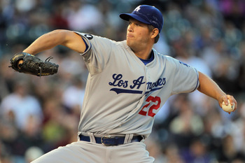 DENVER, CO - APRIL 05:  Starting pitcher Clayton Kershaw #22 of the Los Angeles Dodgers delivers against the Colorado Rockies at Coors Field on April 5, 2011 in Denver, Colorado. Kershaw collected the loss as the Rockies defeated the Dodgers 3-0.  (Photo