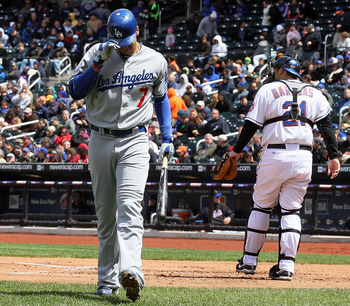 NEW YORK - APRIL 28:  James Loney #7 of the Los Angeles Dodgers walks back to the dugout after striking out in the second inning against the New York Mets on April 28, 2010 at Citi Field in the Flushing neighborhood of the Queens borough of New York City.