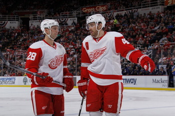 DETROIT, MI - MARCH 30: Brian Rafalski #28 and Henrik Zetterberg #40 of the Detroit Red Wings talk while playing aginst the St. Louis Blues at Joe Louis Arena on March 30, 2011 in Detroit, Michigan.  (Photo by Gregory Shamus/Getty Images)