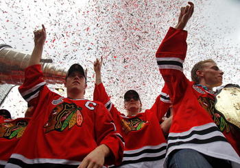 CHICAGO - JUNE 11: (L-R) Jonathan Toews #19, Tomas Kopecky #82 and Patrick Kane #88 celebrate with the crowd during the Chicago Blackhawks Stanley Cup victory parade and rally on June 11, 2010 in Chicago, Illinois. (Photo by Jonathan Daniel/Getty Images)