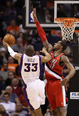 PHOENIX - DECEMBER 10:  LaMarcus Aldridge #12 of the Portland Trail Blazers defends against Grant Hill #33 of the Phoenix Suns during the NBA game at US Airways Center on December 10, 2010 in Phoenix, Arizona.  The Trail Blazers defeated the Suns 101-94.