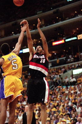 LOS ANGELES - JUNE 4:  Rasheed Wallace #30 of the Portland Trail Blazers shoots a jump shot over Robert Horry #5 of the Los Angeles Lakers during Game 7 of the Western Conference Finals at Staples Center on June 4, 2000 in Los Angeles, California. The Lak
